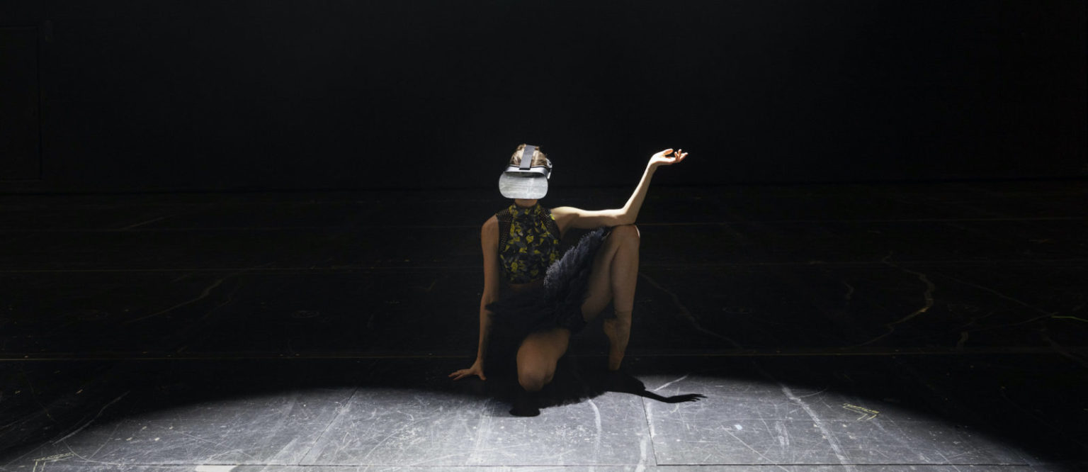 Woman wearing a dress and XR glasses sitting on the floor