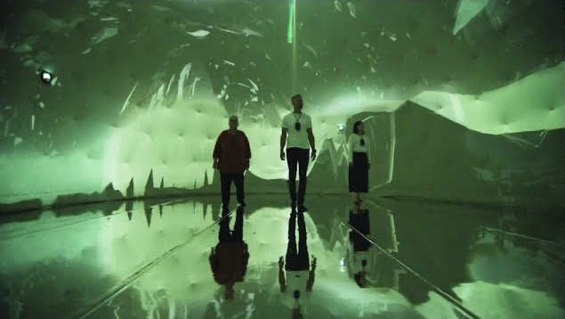 Three people standing in the Laila dome surrounded by green projections