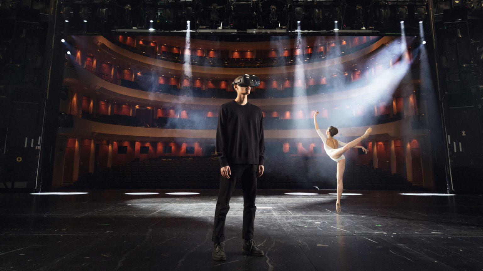 Man with VR goggles and a ballet dancer on the main stage of the Finnish National Opera and Ballet
